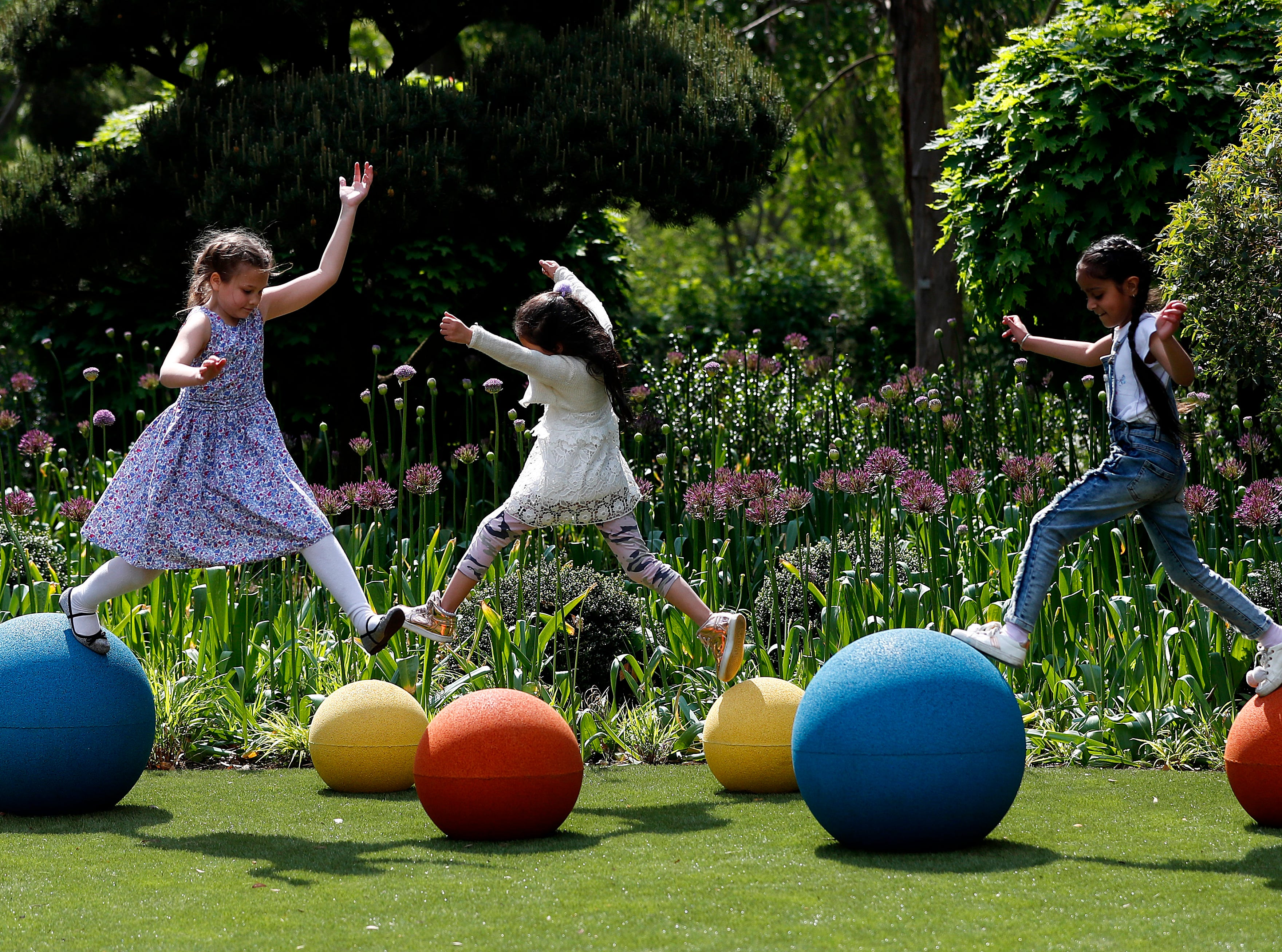 Children enjoy the new Children's Garden at Kew, designed around the elements that plants need to grow, at Kew Gardens in London, Thursday, May 16, 2019. The new garden covers the equivalent of nearly 40 tennis courts, and is for youngsters to explore and play in.