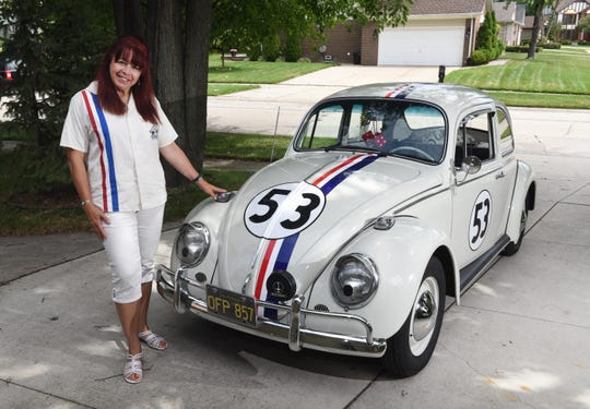 Lynn Anderson of Clinton Township stands by her prized possession, a 1965 replica of Herbie the Love Bug, in 2015.