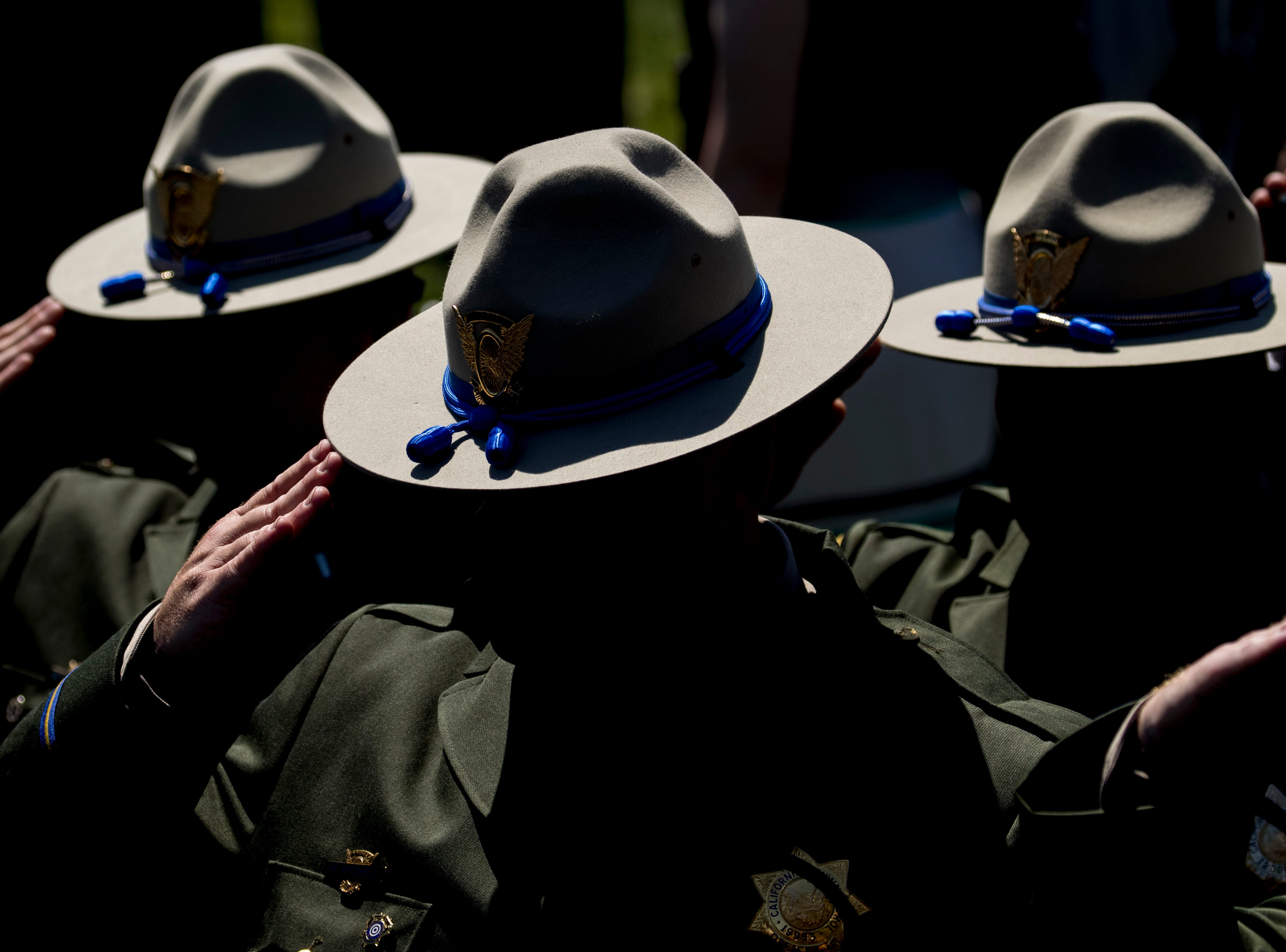 Law enforcement officers salute during the 38th Annual National Peace Officers Memorial Service on the West Lawn of the Capitol Building, Wednesday, May 15, 2019, in Washington, D.C.