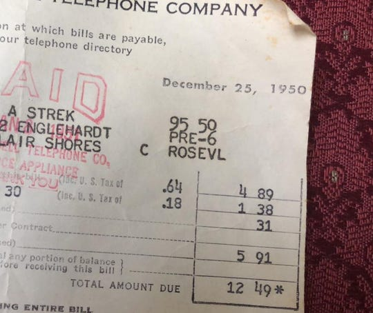 A phone bill from December 25, 1950 for the Strek family shows their balance as $12.49. The phone number stayed in the family for almost seven decades.