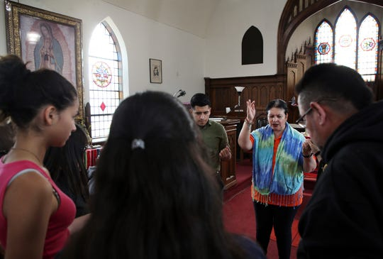 Pastor Jacobita Cortes offers a prayer at Lincoln United Methodist Church in Chicago on Wednesday, May 15, 2019, for Marlen Ochoa-Lopez, a pregnant woman who was reported missing on April 23, 2019.