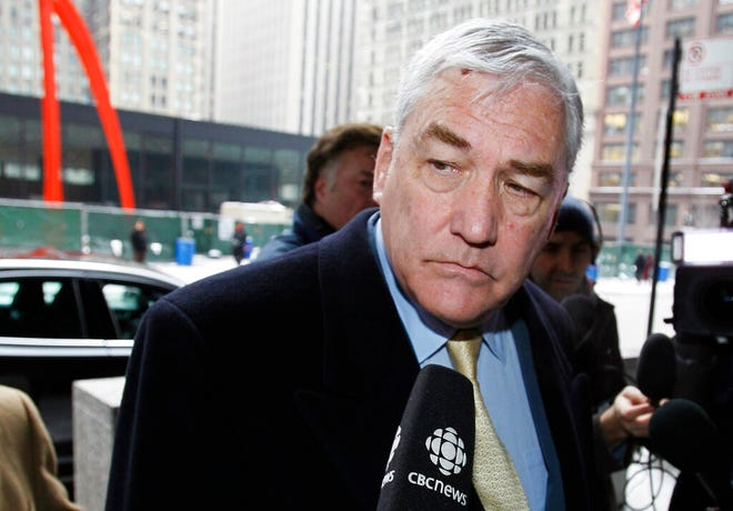 In this Jan. 13, 2011 file photo, Conrad Black arrives at the federal building in Chicago. President Donald Trump has granted a full pardon to Black, a former newspaper publisher who has written a flattering political biography of Trump.