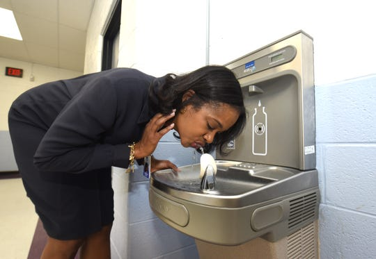 Machion Jackson, assistant superintendent of operations, Detroit Public Schools Community District, drinks from one of the new hydration stations inside the Herman A. Breithaupt Career and Technical Center on Tuesday, May 14, 2019 as the district moves to install hundreds across the district.