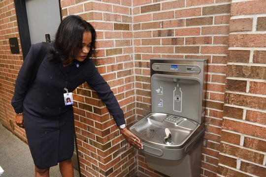 Machion Jackson, assistant supervisor of operations, Detroit Public Schools, shows one of the new hydration stations inside the Herman A. Breithaupt Career and Technical Center on Tuesday, May 14, 2019 as the district moves to install hundreds across the district.