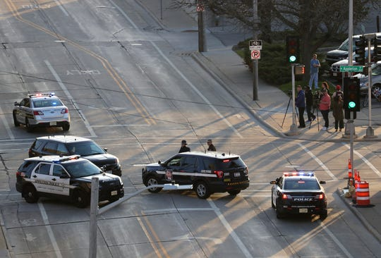In this Wednesday, May 15, 2019 photo, authorities investigate the scene of a shooting at the Valley Transit Center in Appleton, Wis.
