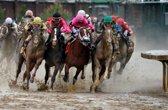 War of Will, second from left, avoids a collision with Maximum Security in the final turn of the Kentucky Derby.