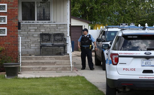 Chicago police watch over a home in Chicago, Wednesday, May 15, 2019, where Marlen Ochoa-Lopez was strangled and her baby cut from her womb, police and family members said.