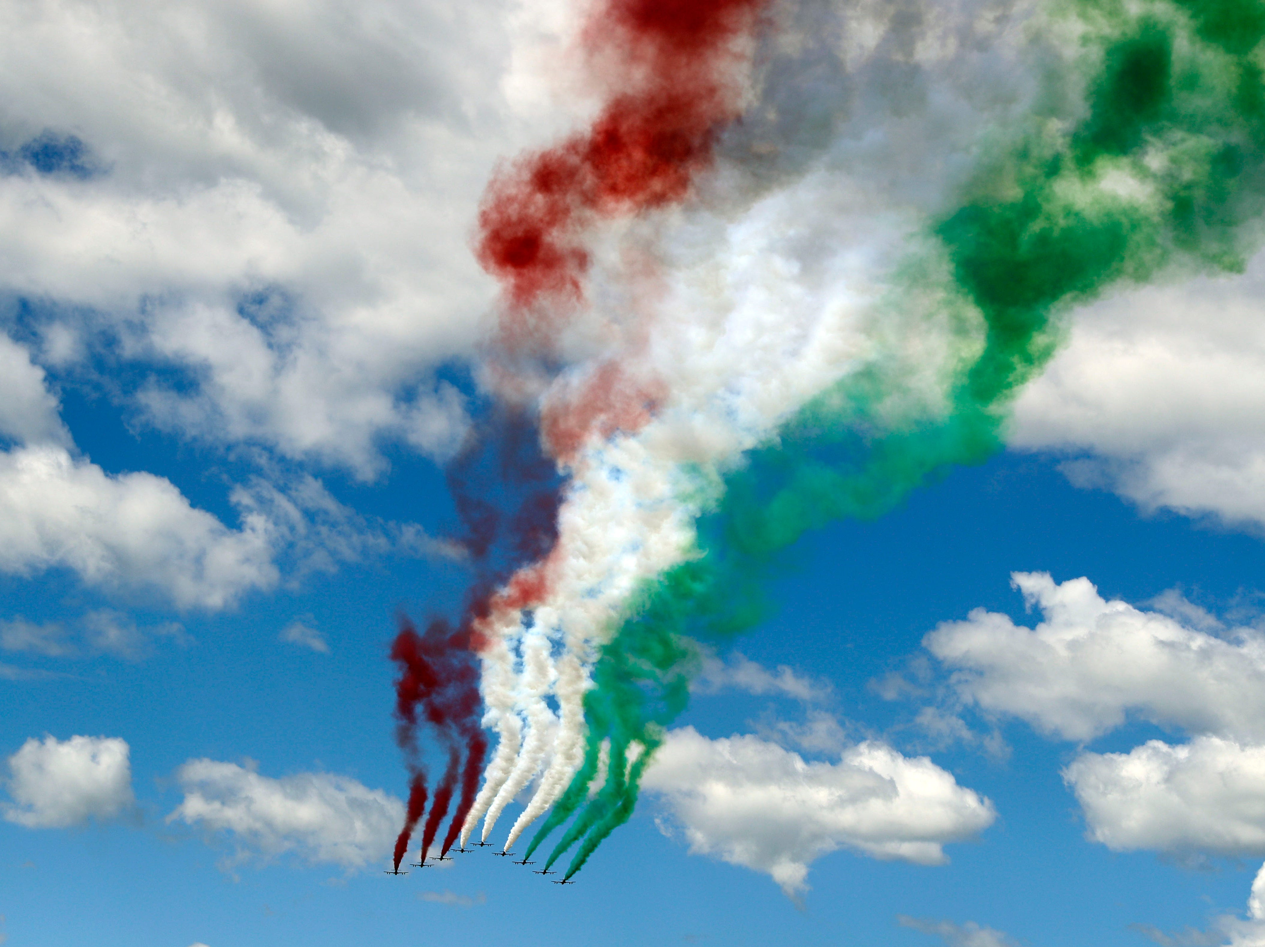 Italian aerobatics team the Tricolor Arrows fly over the central court stadium during the Italian Open tennis tournament, in Rome, Thursday, May, 16, 2019.