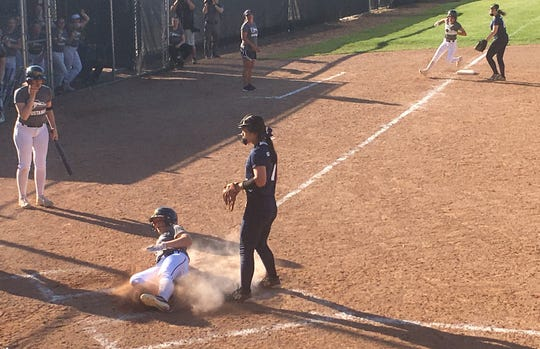 Sophie Varney scores in the second inning of the second game.