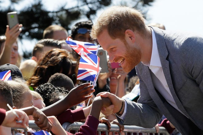 Britain's Prince Harry, The Duke of Sussex meets members of the public as he arrives for a visit to Barton Neighbourhood Centre in Oxford, England Tuesday, May 14, 2019.