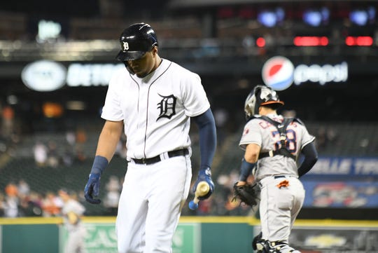 Tigers' Jeimer Candelario walks off the field after striking out swinging to end the game.