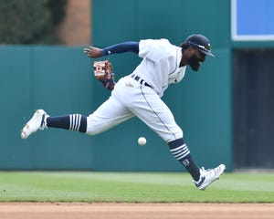 Tigers second baseman Josh Harrison can't get to the ball in the fifth inning of Thursday's loss.