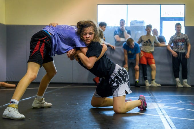 Kaylie Petersen, right, wrestles Reed Egli during a practice at Maurer Coughlin Wrestling Club in Evansville, Ind., Tuesday, April 23, 2019. She's been attending practices and receiving coaching at MCWC since 2014 and is often the only girl in the room.