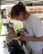 Sarah Spelbring of Bee Sharp will sharpen your knives while you shop at the Franklin St. Bazaar.