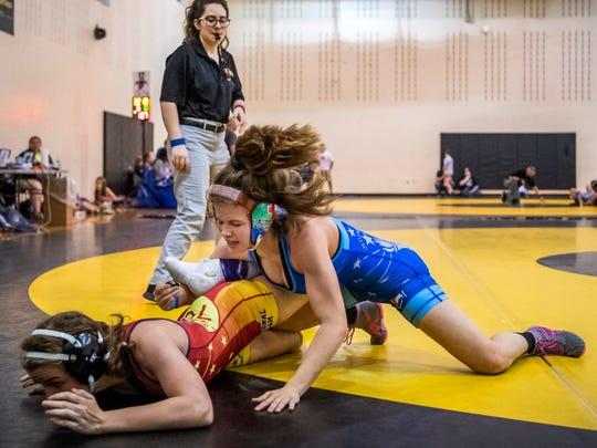 Kaylie wrestles senior Ciera Broukal in an exhibition match following the Indiana State Wrestling Association Women's Freestyle State tournament at Avon High School in Avon, Ind., Sunday morning, May 5, 2019. Broukal, a member of the Bloomington South Wrestling Club, won the practice match.