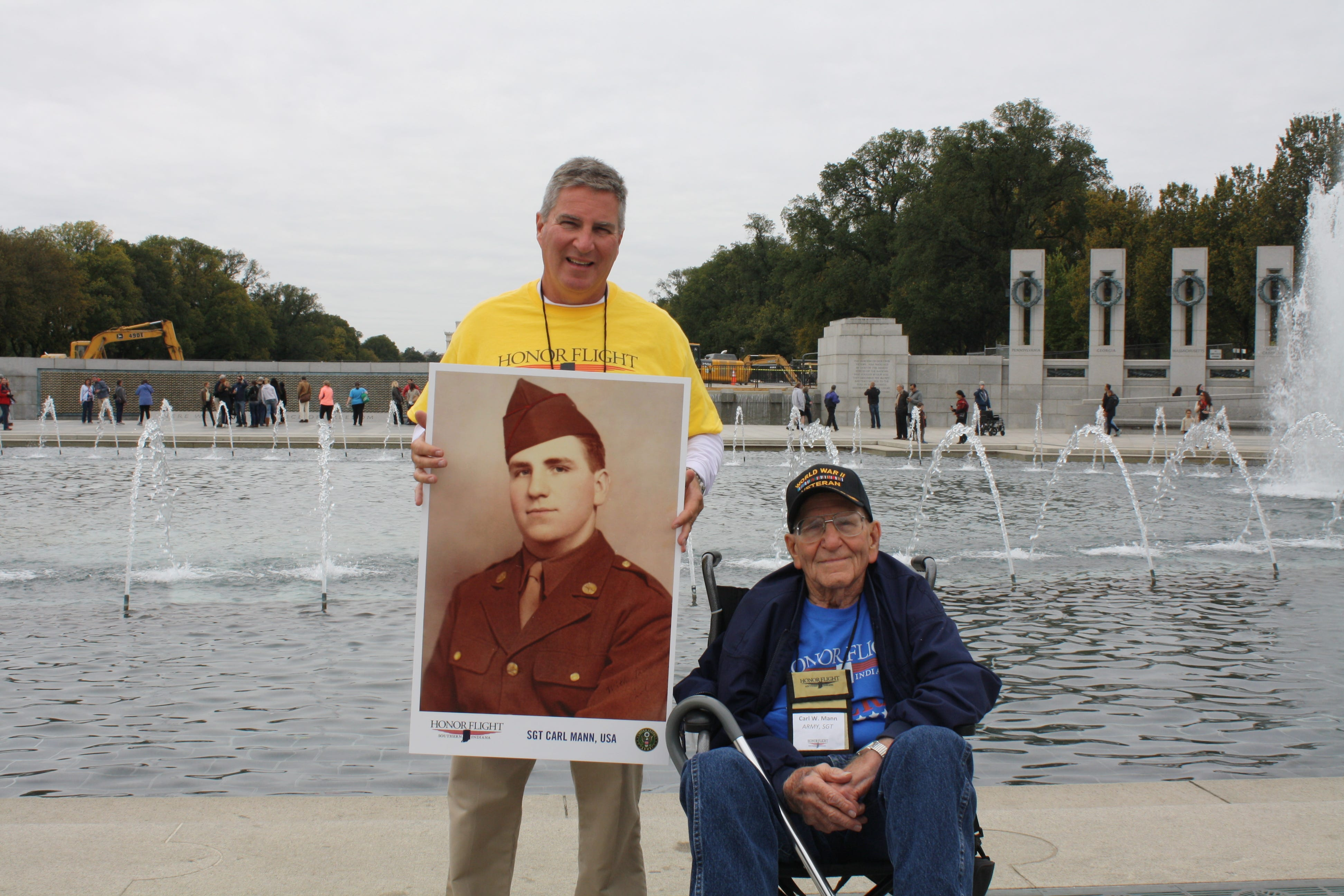 Miles Mann (left) and Carl Mann visited the WWII Memorial during his Honor Flight in 2015.