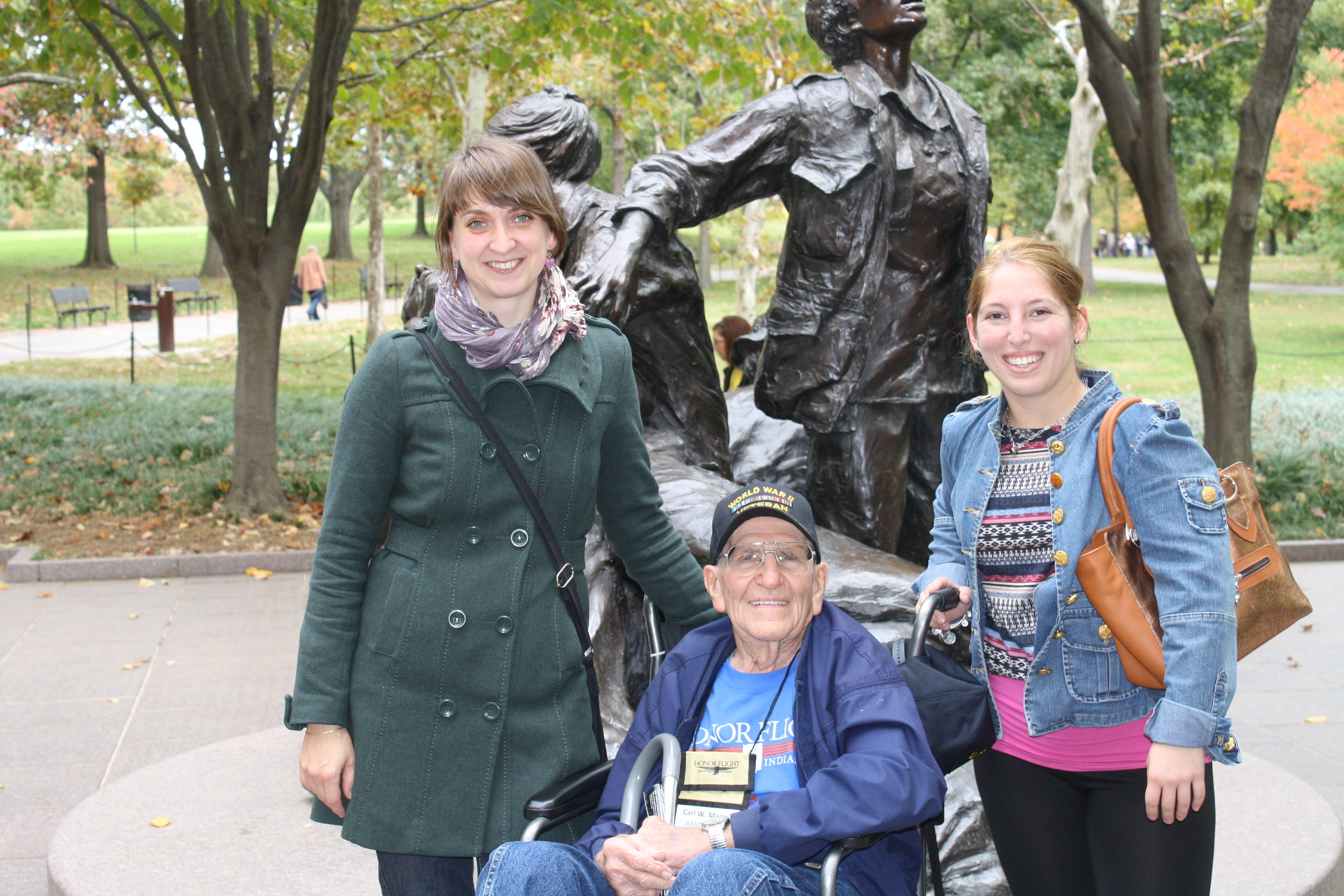 Carl Mann pictured at the Vietnam Women's Memorial. These two women are from Norway, where Mann helped liberate concentration camps.