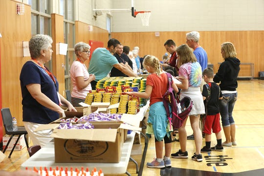 Volunteers help students fill backpacks with school supplies, Saturday August 20, 2016, at the Fond du Lac Family YMCA during the Fond du Lac Back to School program which pairs low income students with donated school supplies. The program was a victim of the March flooding and needs help replacing $5,000 worth of lost supplies. Doug Raflik/USA TODAY NETWORK-Wisconsin