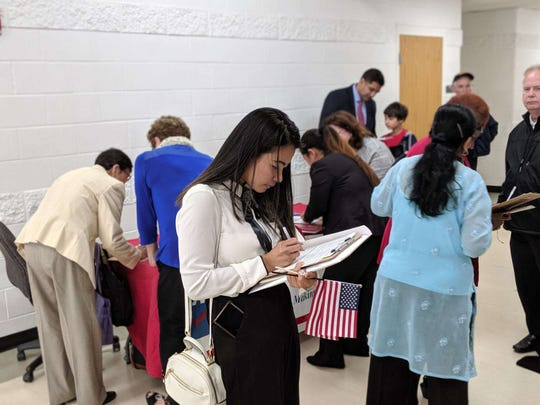 Ten minutes after becoming a U.S. citizen, Eden May Baron Ibanez, filled out registration to become an active voter.