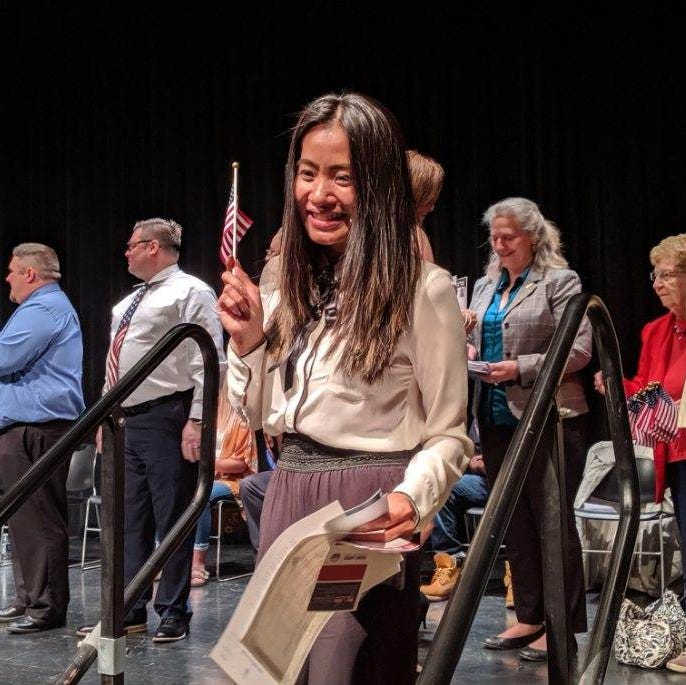 New citizens pledge allegiance to America during naturalization ceremony