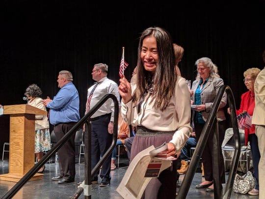 Eden May Baron Ibanez of the Philippines was all smiles as she became an official United States citizen Thursday.