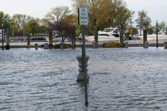 Flooding near Waterworks Park on Sunday forced the city of Port Clinton to put up barricades to warn residents of high water. The city declared a state of emergency Thursday due to high water and wave action eroding Port Clinton's shoreline and impacting its pump stations.