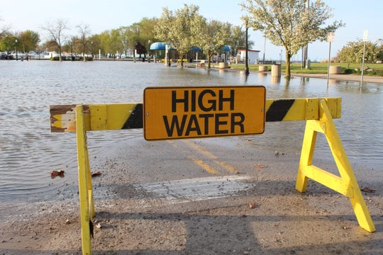 This high water sign, put up by Port Clinton city officials on Sunday by Waterworks Park, has become a common sight in recent months. The city declared a state of emergency Thursday and closed City Beach after high water levels and wave action pounded the beach and caused severe erosion.