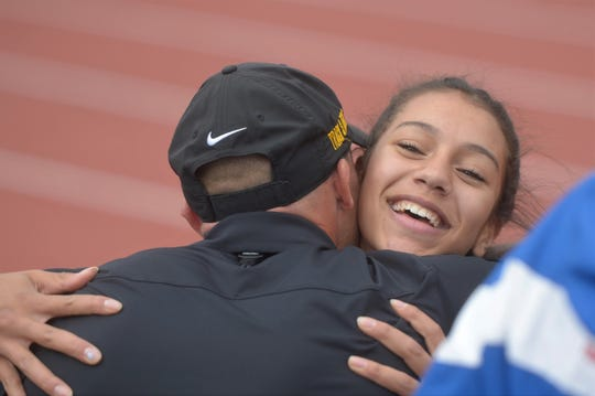 Fort Collins High School's Taryn Burkett hugs coach Conrad Crist after winning the 5A triple jump at the state meet at Jeffco Stadium on Thursday, May 16, 2019.