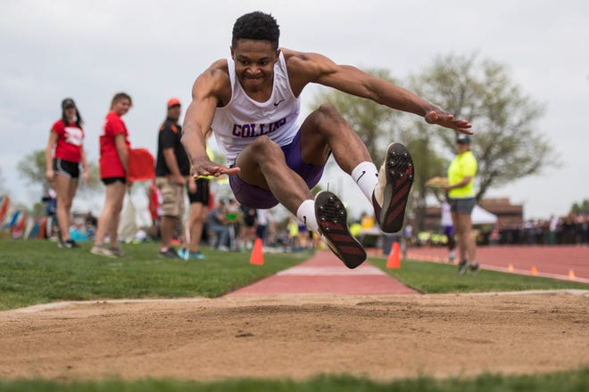 Fort Collins High School senior Micaylon Moore competes in the boys 5A triple jump during the first day of the Colorado state high school track and field championships on Thursday, May 16, 2019, at Jeffco Stadium in Lakewood, Colo.