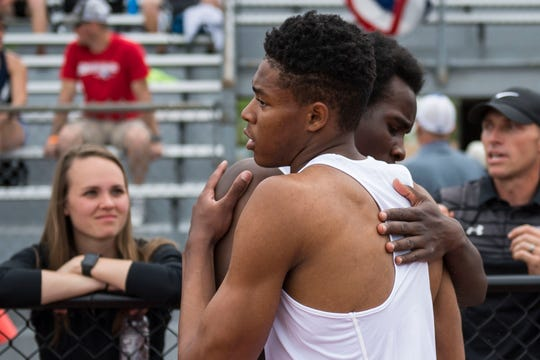 Fort Collins High School senior Micaylon Moore, front, and Allam Bushara hug after placing first and second in the boys 5A triple jump during the first day of the Colorado state high school track and field championships on Thursday, May 16, 2019, at Jeffco Stadium in Lakewood, Colo.