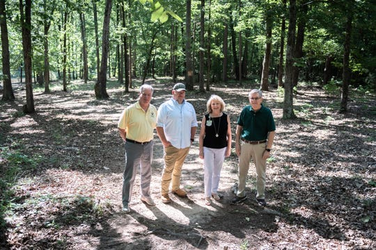 Bud Marchant, the Executive Director of the Laurens County Trails association, Andy Howard, the Laurens County Parks and Rec. director, Jamie Adair, community relations for Prisma Health southern region, Don Walker, the former Executive Director of the Laurens County Trails association, who are all also on the Trails Association board of directors, standing in an area of a planned Swamp Rabbit Trail section in Laurens County Park, which will eventually connect Laurens and Clinton.