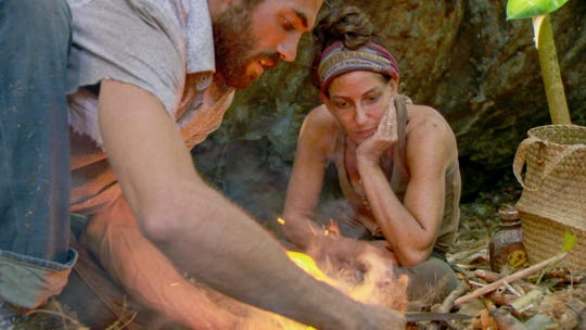 "Chris Underwood shows fellow player how to make fire on ""Survivor: Edge of Extinction."""
