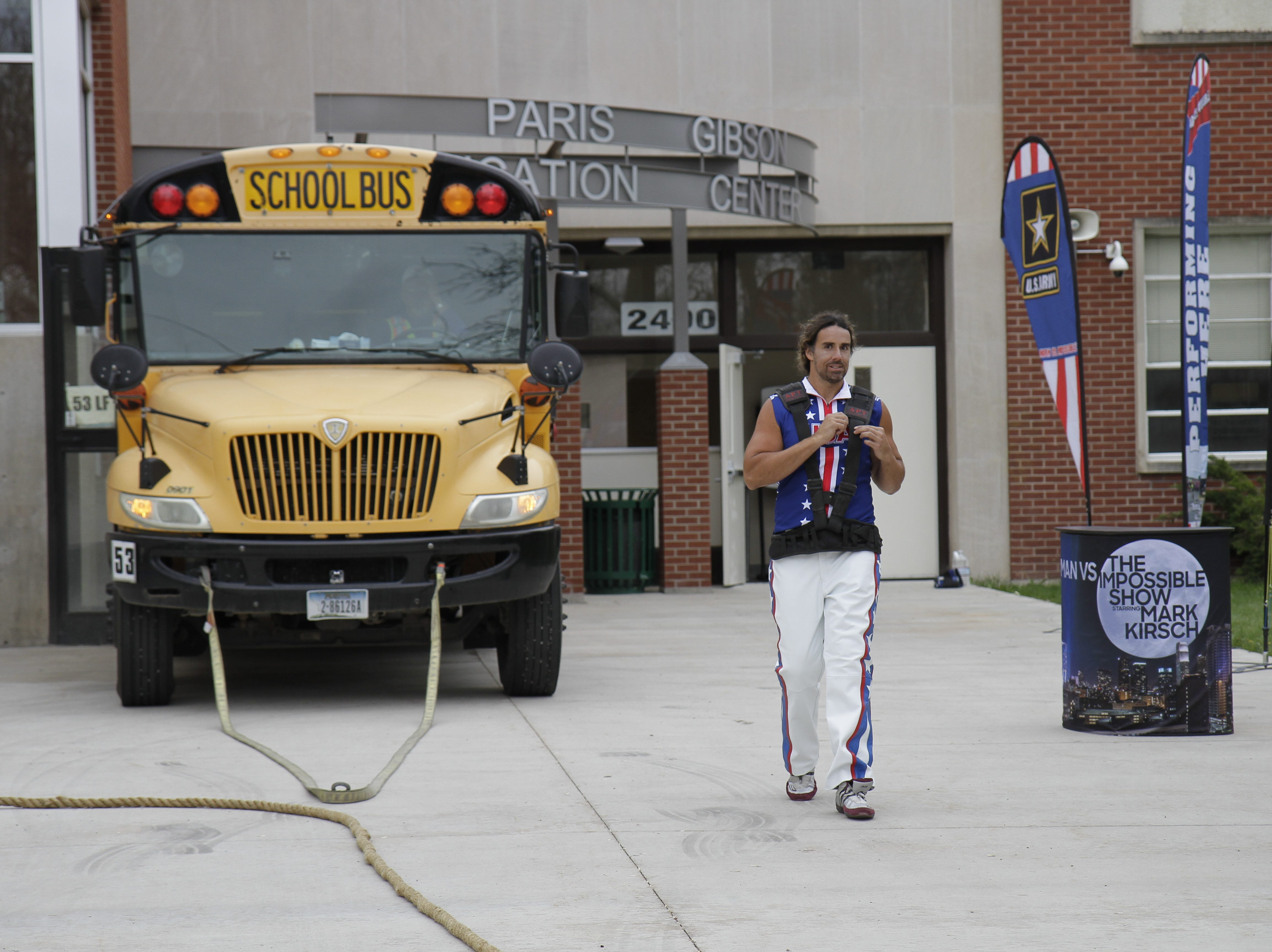 Mark Kirsch getting ready to give the green light for students to board the bus to their next destination.
