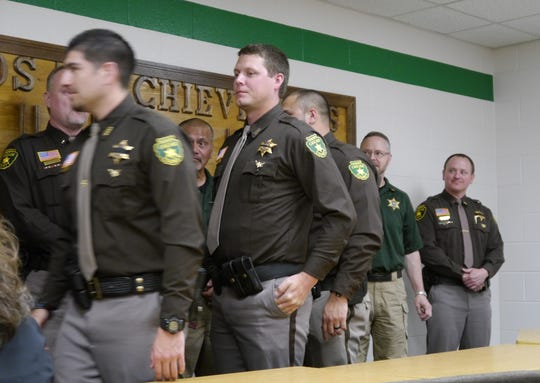 Deputies line up to shake hands as Cascade County gives Certificates of Appreciation, Lifesaving Awards and a Distinguished Service Award to staff and members of the public Thursday.
