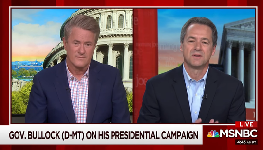 "Gov. Steve Bullock, right, talks Thursday with ""Morning Joe"" co-host Joe Scarborough."