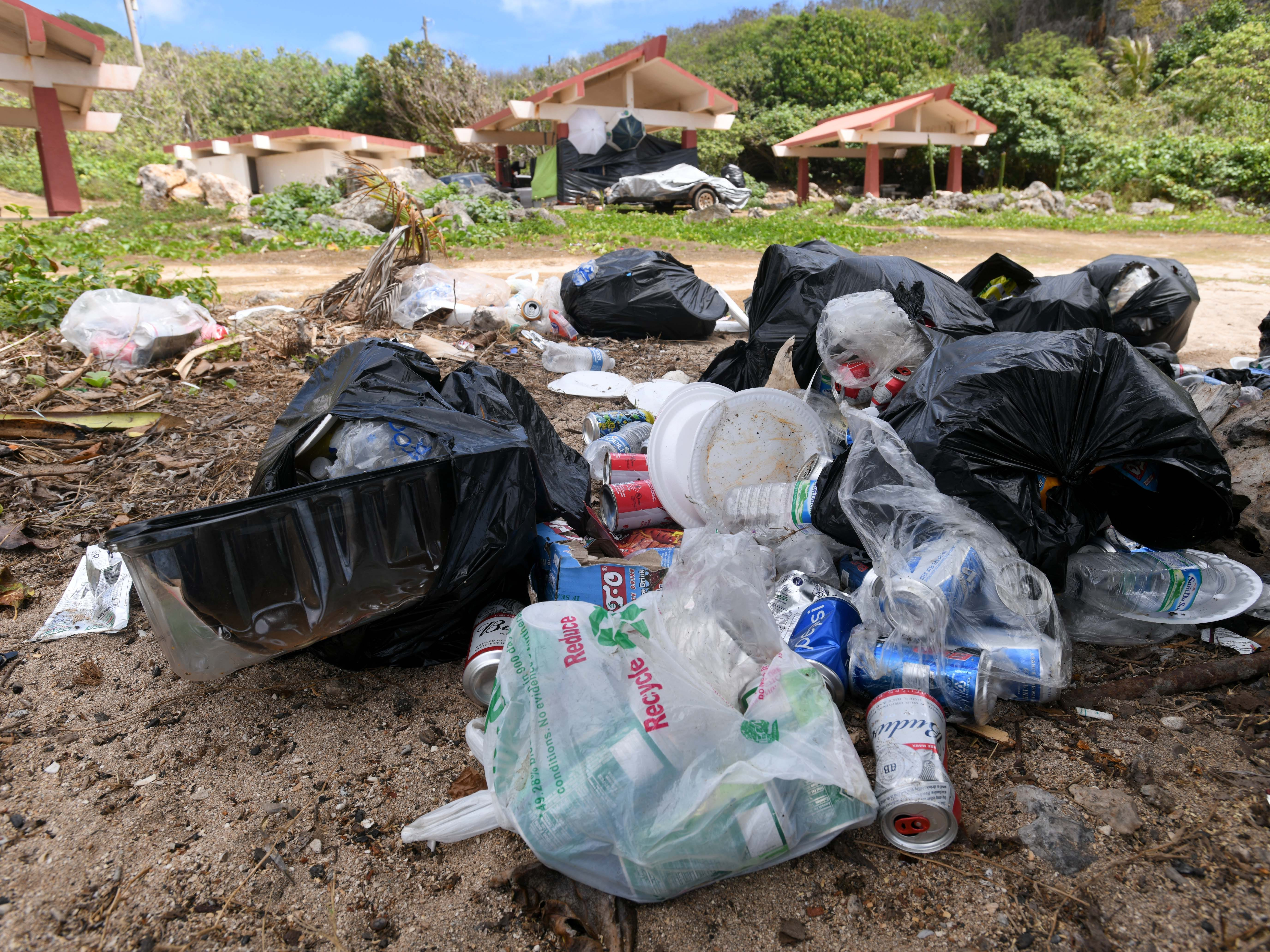 Bags of garbage can be found left behind at Taga'chang Beach Park on Thursday, May 16, 2019.