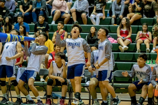 Harvest Christian Academy players react at the IIAAG Boys Volleyball championship game on May 15.