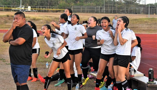 "The Cougar bench celebrates a game-tying goal from Inina Yatar on a corner kick by Cori-Nicole ""Coco"" Paulino."
