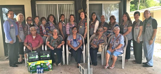 "Guam Sunshine Lions Club members, in conjunction with their primary service project of ""caring for the sick and the elderly,"" brought song, cheer, and supplies to Ray Cruz, 78, of Nimitz Hill Estates on May 11. Seated from left: Ray Cruz, Victoria Sablan, L. Dee Cruz, L. Jovie Mejorada, and L. Helen Mendiola. Standing from left: Lions Frank Aguon, Jr., Lola Flores, Jill Pangelinan, Marie Salas, Sid Weedin, Loraine Rivera, Tish Tano, Julie Cruz, Doris Cruz, Annie Artero, Helen Colby, LouJean Borja, Clarice Quichocho, Marietta Camacho, and Pete Babauta."