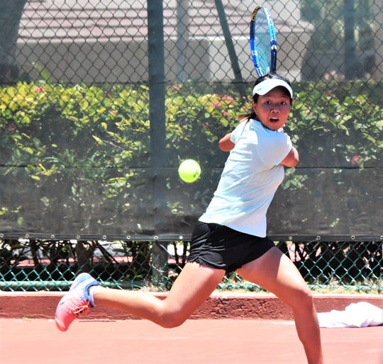 Hong Kong's Wing Ka Lin eyes a backhand against Japan's Harune Shigemasu during singles action Thursday at the 2019 Chuck E. Cheese ITF World Tennis Tour Juniors Event held at the Hilton Guam Resort and Spa.