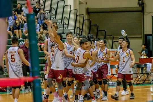 Father Duenas Memorial School huddle to celebrate after beating the Harvest Christian Academy at the IIAAG Boys Volleyball championship game on May 15.