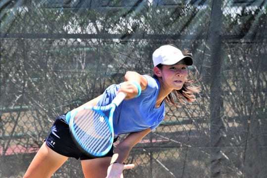 Japan's Rio Osoegawa serves during singles action Thursday at the 2019 Chuck E. Cheese ITF World Tennis Tour Juniors Event held at the Hilton Guam Resort and Spa.