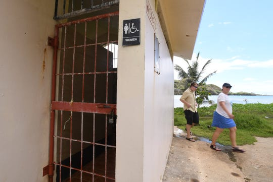 A metal gate restricts access to the women's restroom facility at Talofofo Beach Park on Thursday, May 16, 2019. Access, however, was open to the men's restroom on the other side of the building.