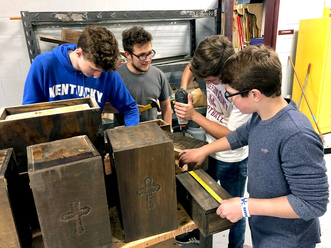 From left, Cullin Gardner (junior), Ian Cosby, (sophomore), Isaac Damrath (junior) and Gabe Turner (sophomore) work together on building bereavement boxes.
