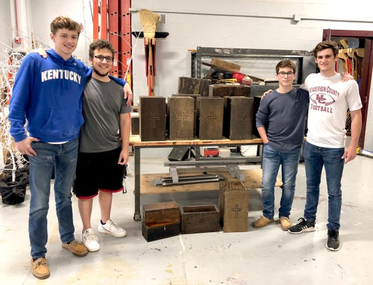 From left, Cullin Gardner (junior), Ian Cosby, (sophomore), Gabe Turner (sophomore) and Isaac Damrath (junior) are among some of the students from Henderson County High School's Construction/Carpentry class that worked on the bereavement box project.