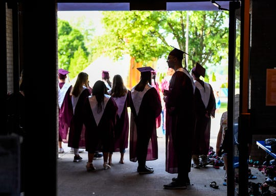 Seniors hang out by the front door as fellow graduates from Henderson's South Heights Elementary return for a walk through the school's halls and to see their former teachers Thursday on the last day of school.