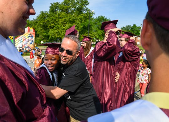 Longtime Principal Rob Carroll -- who is retiring after 27 years of school service -- hugs Nyshawna Robinson as 2019 graduates from Henderson's South Heights Elementary return for a walk through the school's halls and see their former teachers on Thursday, which was the final day of school.