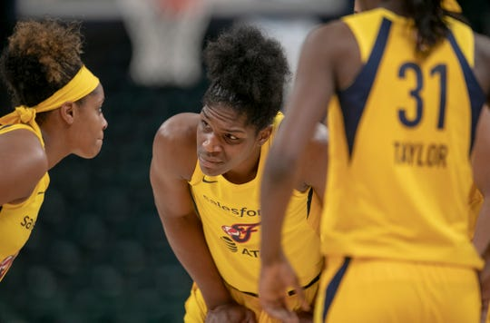 Teaira McCowan (middle), chats with Indiana teammates, during a break in the action, Chicago Sky at Indiana Fever, WNBA preseason, Bankers Life Fieldhouse, Indianapoolis, Wednesday, May 15, 2019. Indiana won 76-65.