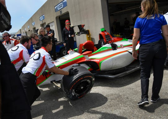 Patricio O'Ward of Team Carlin pushes his car into their garage following his crash into turn 2 during practice for the Indianapolis 500 at the Indianapolis Motor Speedway on Thursday, May 16, 2019.