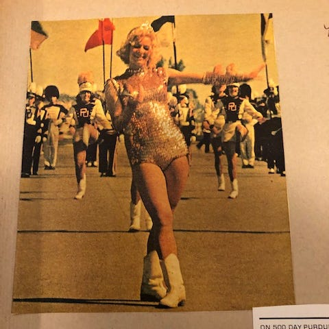 """June Ciampa Lauer led the Purdue """"All-American"""" Marching Band as the Golden Girl in the early 1960s."""